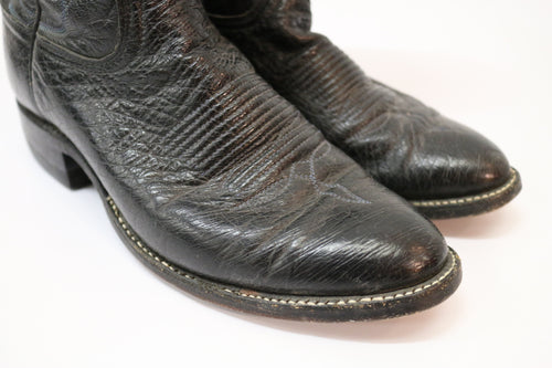 Black Western boots with blue top stitching
