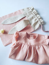 Load image into Gallery viewer, bunny bag and ruffle dress in peachy pink linen with bunny ears and fluffy tail. Great to use as slippers bag, toys bag or diaper container.