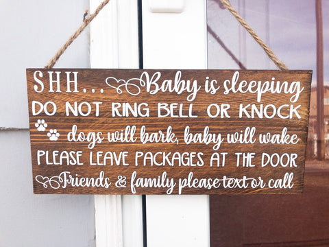 Shh baby is sleeping do not ring bell or knock, dogs will bark, baby will wake, please leave packages at the door.. wooden front door sign