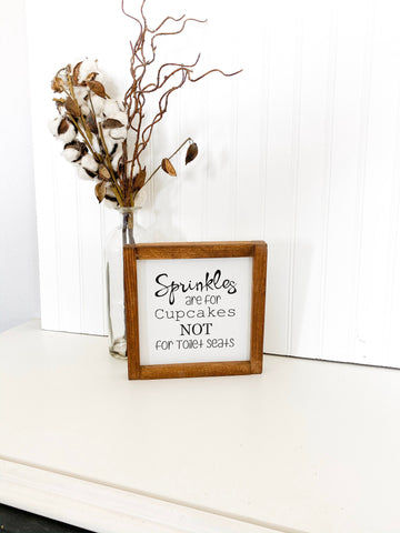 Sprinkles are for cupcakes NOT for toilet seats framed wooden bathroom sign. Cute farmhouse framed bathroom sign decor. Funny framed sign