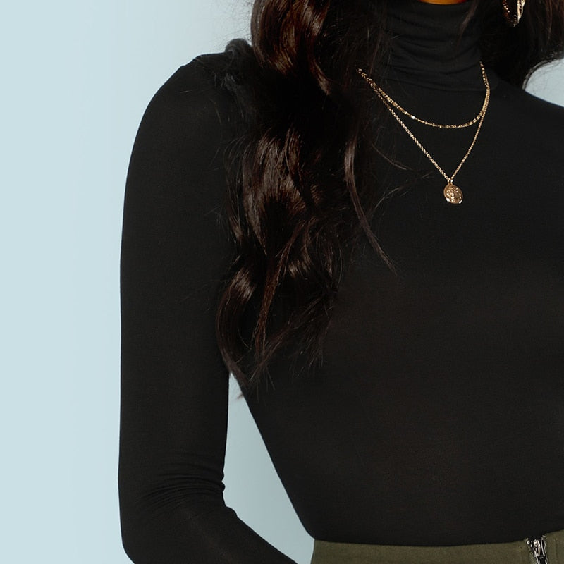 Tops:roll neck top in black:VENERA CLUB