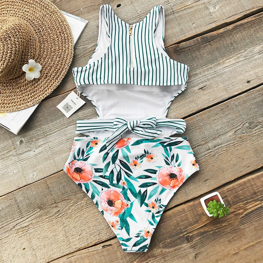 cut out waist swimsuit with zip detail in floral and stripe