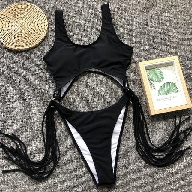 cut out swimsuit with tassel and ring detail