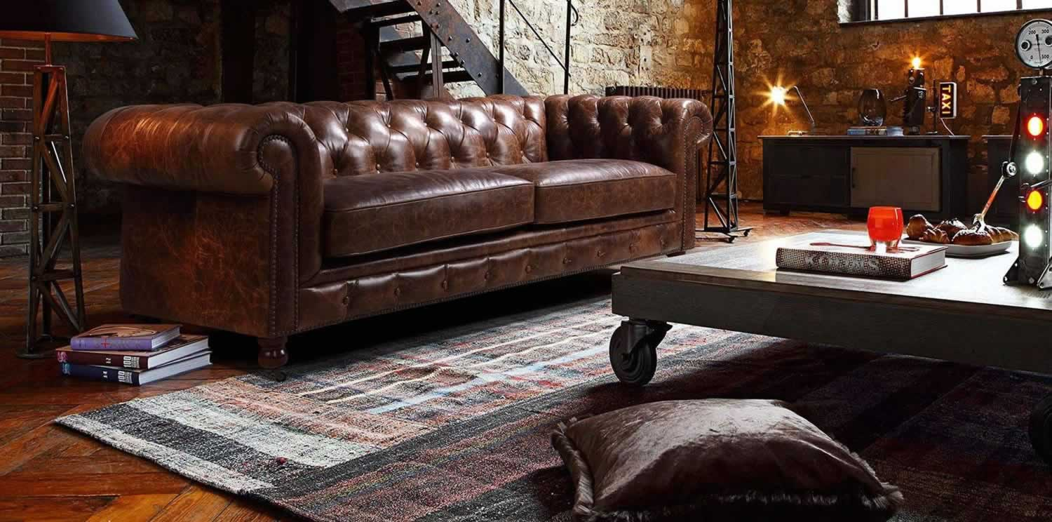 Leather Chesterfield sofa in loft style livingroom