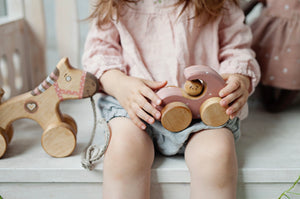 Wooden pink toy car