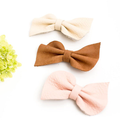 Leather fan bow on clip - rose blush