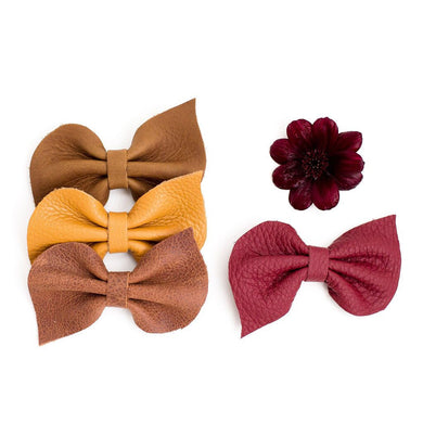Leather fan bow on clip - ruby