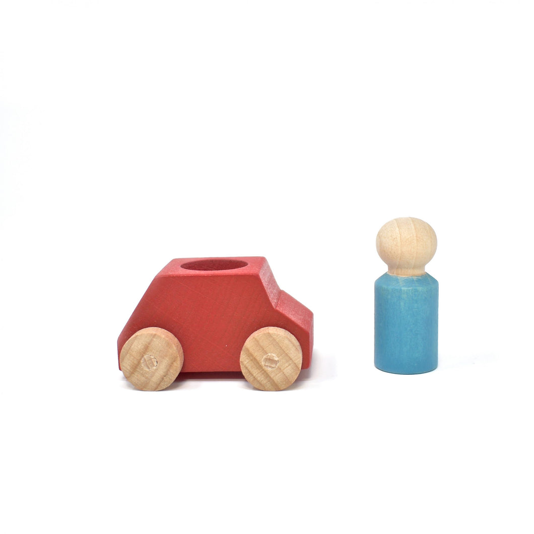 Red wooden car with turquoise figure