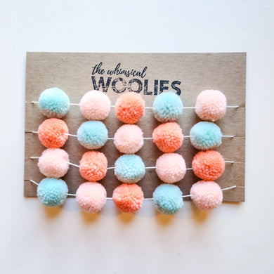 Yarn pom snowball garland - pink & teal