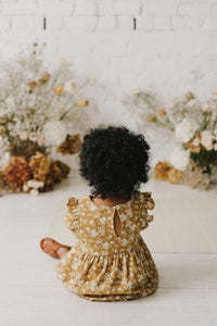 Jamie Kay golden floral dress