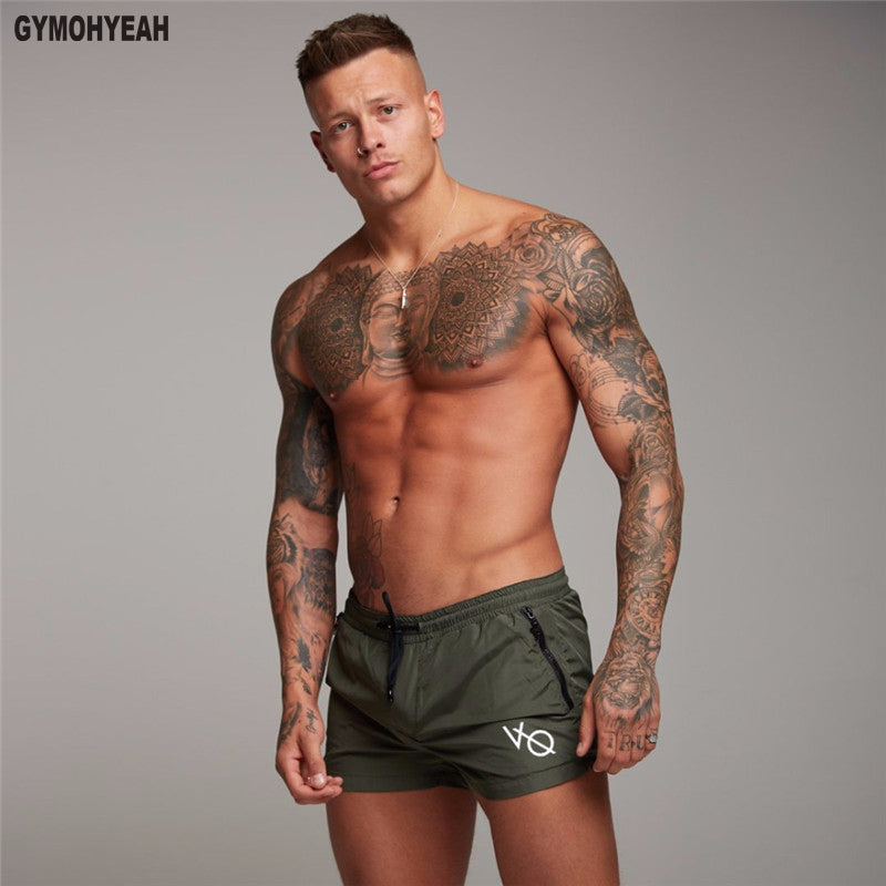 summer style Men's Shorts Joggers sweatpants compression Fast drying gyms bodybuilding Jogger Beach Shorts Sexy men clothing