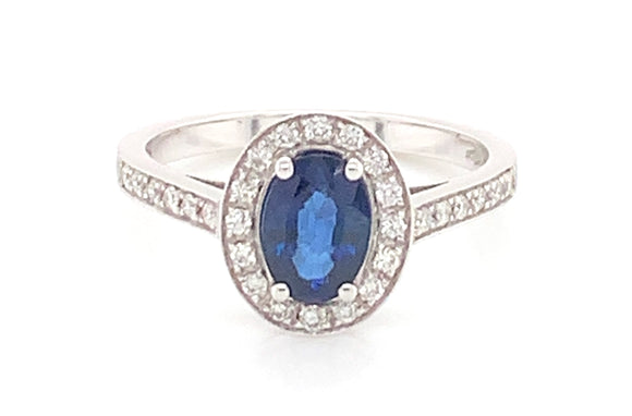 18ct White Gold 0.30ct Diamond And 1.25ct Sapphire Oval Halo Ring