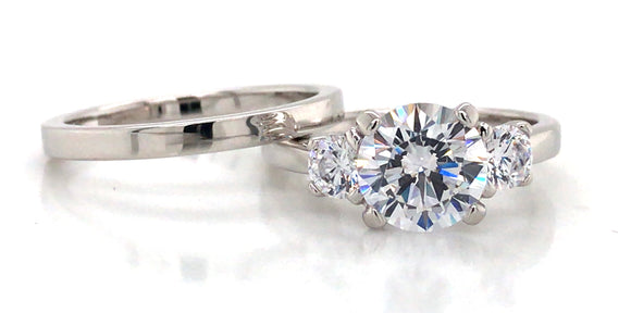 Sterling Silver Cz Three Stone And Plain Band Ring Set