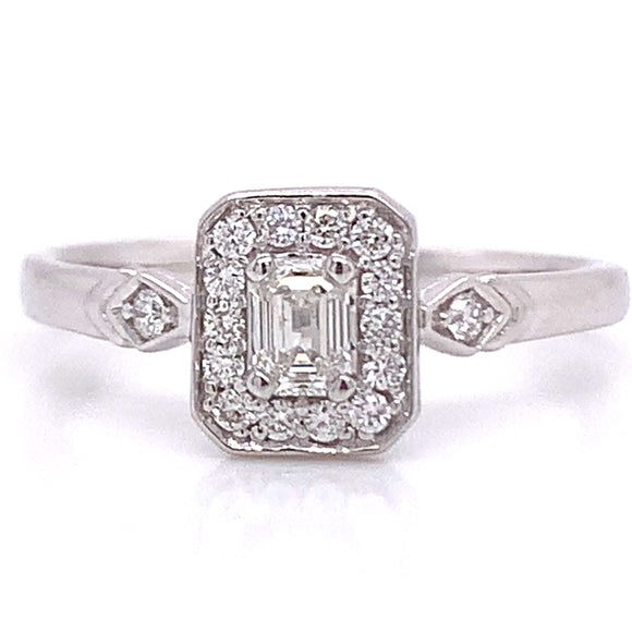 Emerald Cut Diamond Halo With Side Detail White Gold