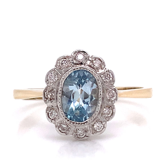 Oval Topaz with Diamond Cluster