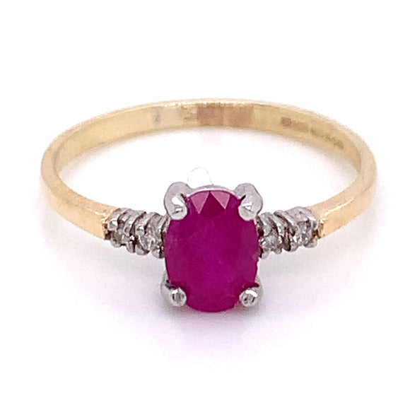 Oval Ruby with Side Diamond Detail