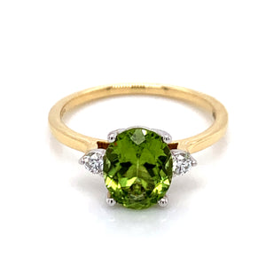 2ct Oval Peridot with .10ct round Brilliant Side stones set in 18ct Gold