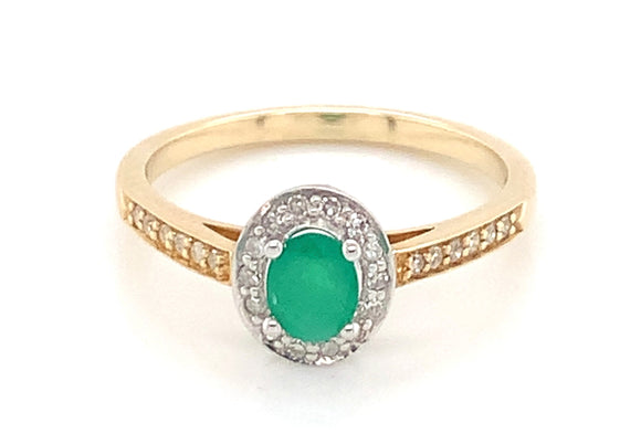 9ct Yellow Gold Oval Emerald And 0.13ct Diamond Halo Ring With Diamond Set Shoulders
