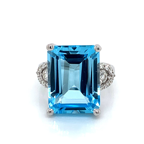 14ct Blue Topaz with 0.35ct Diamond Side Accent Ring