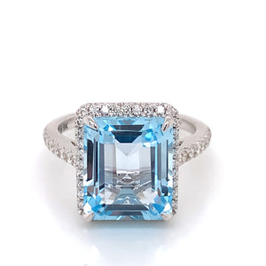 8ct Sky Blue Topaz with .40ct Diamond Castel Set Halo Ring