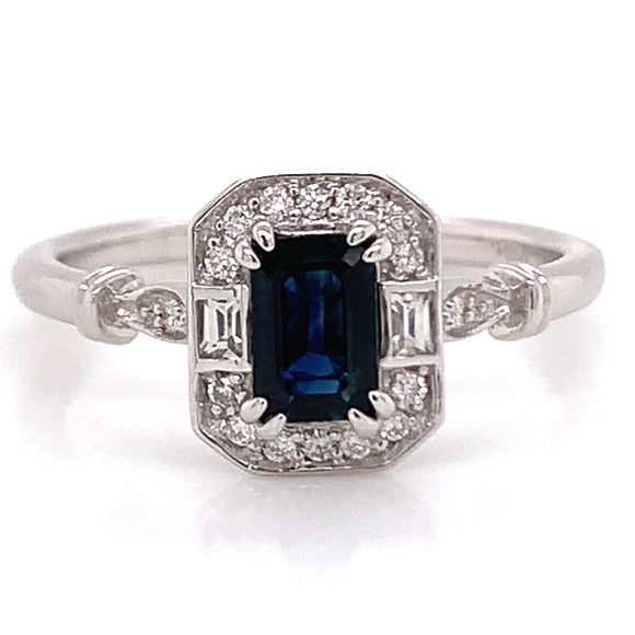.60ct Navy Emerald Cut Sapphire Ring with White Sapphire & Diamond Mounting.