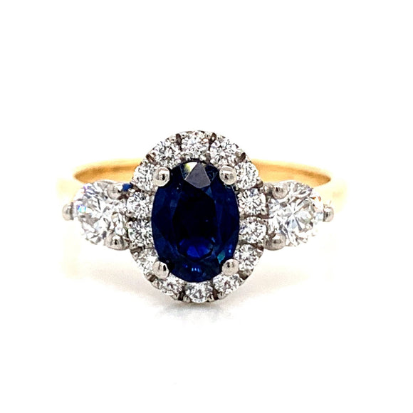 18ct Gold Oval Sapphire Halo with Side Diamonds