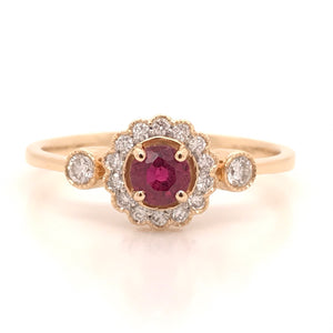 Ruby and diamond halo with two side stones