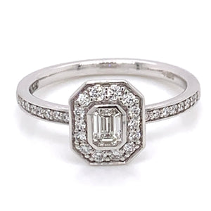 18ct White Gold Rub Over Emerald Cut Diamond Halo Ring
