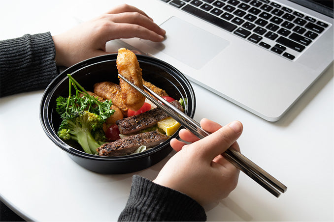 Eating bento bowl with titanium chopsticks.