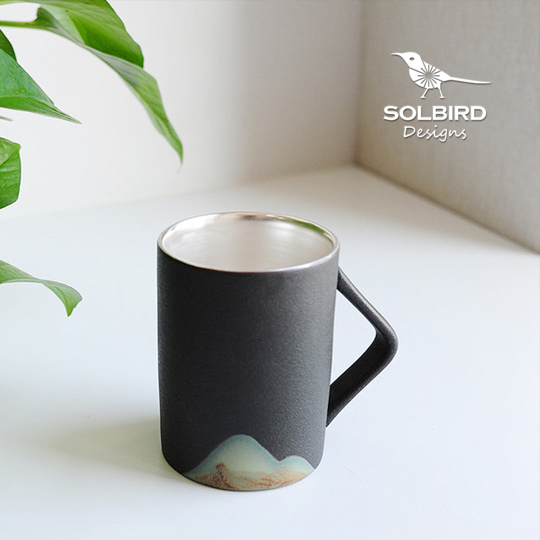 "<b><font color=""black"">Silver-lined Porcelain Mug </font></b> <br>Sol-Bird - Kranite"