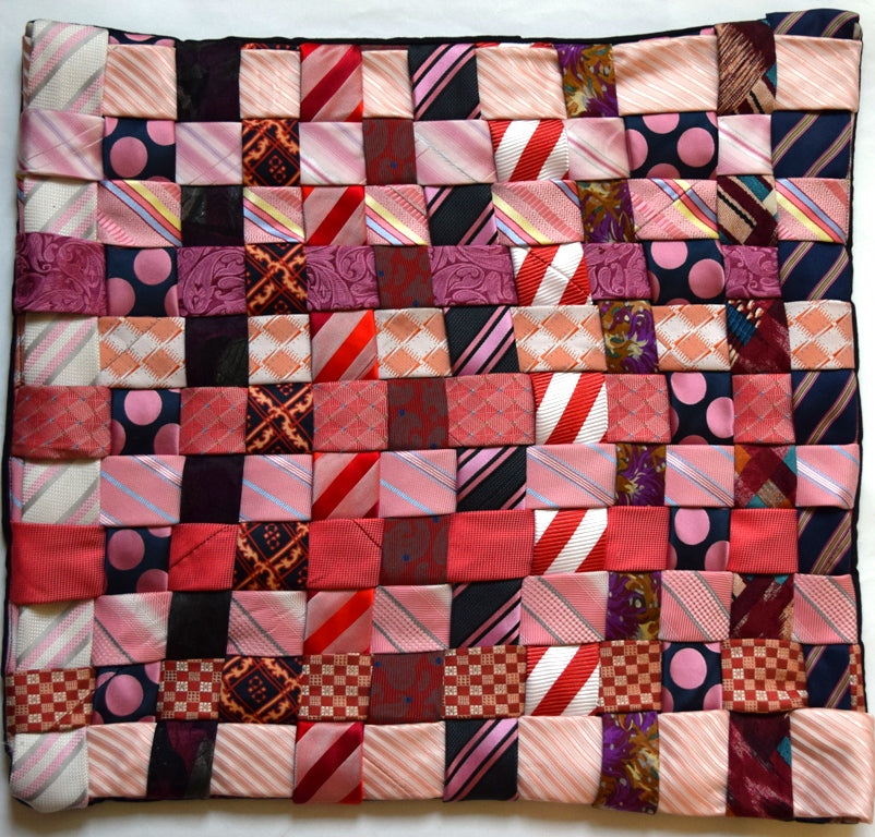 Cushion cover, woven ties, pinks