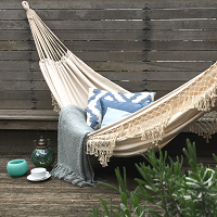 white tasselled hammock