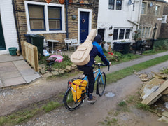 Unhealthy way to carry a guitar on a bike
