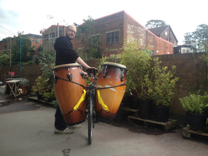 Airpannier for carrying drums and percussion on a bike.