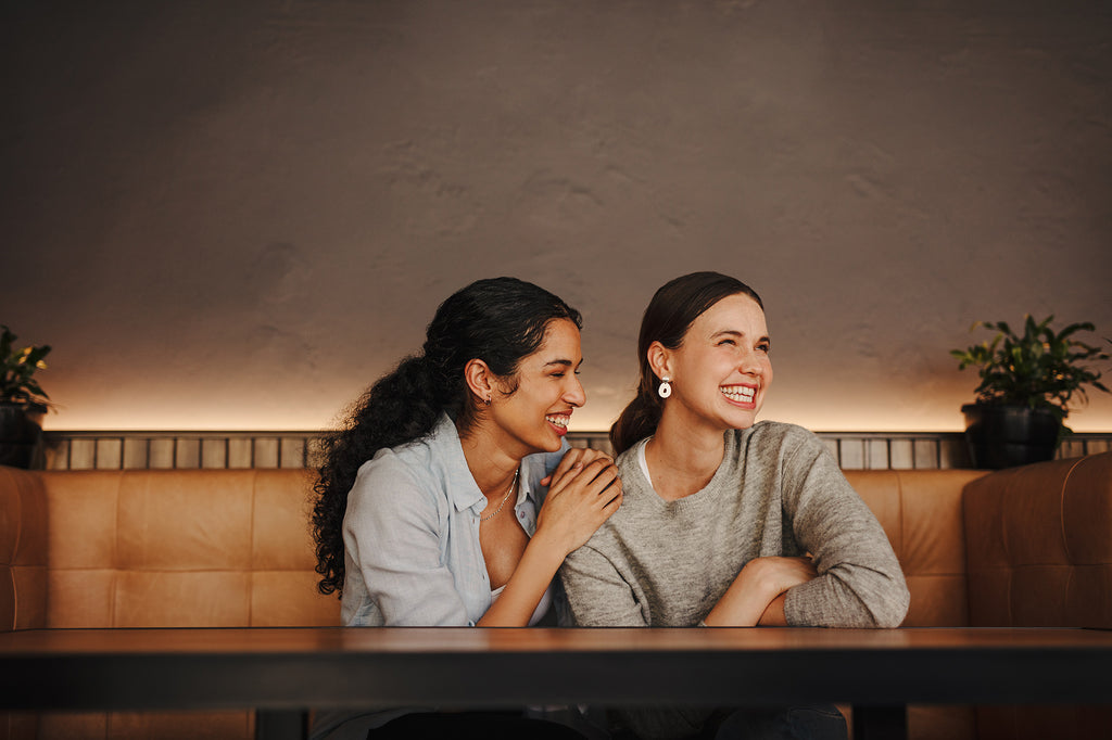 Friends having a great time meeting in a cafe