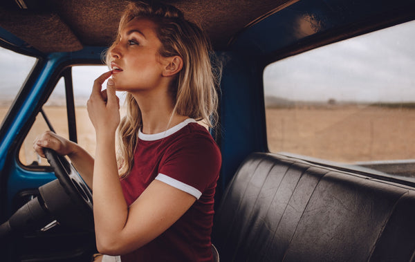 Beautiful woman on a road trip