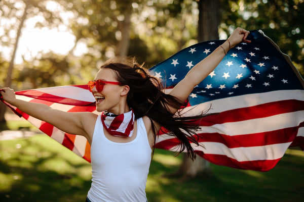 American woman with national flag at park