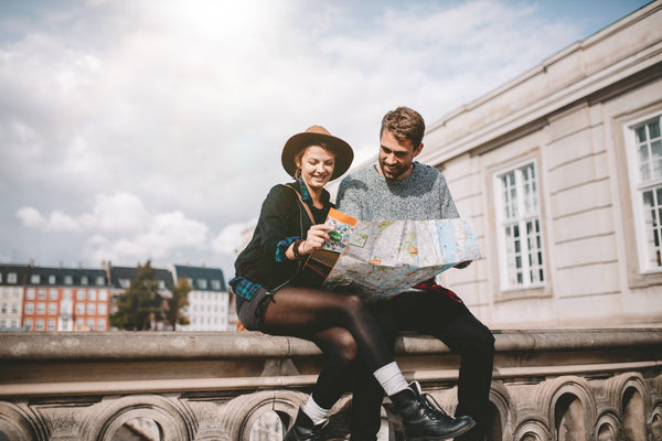 Young couple looking at a city map.