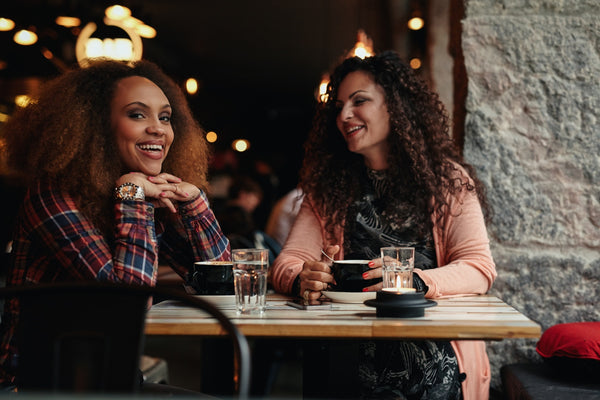 Two female friends at cafe