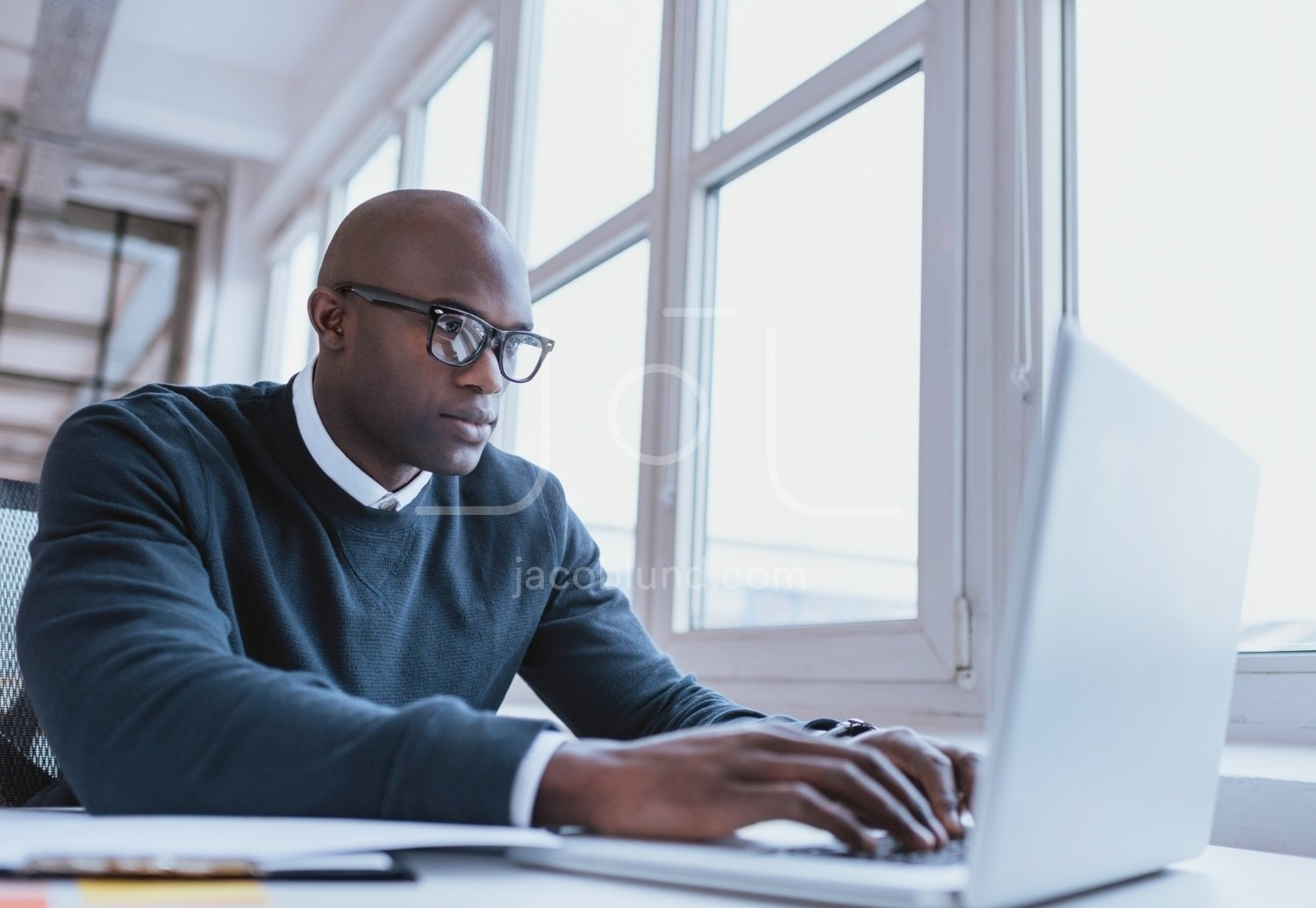 African American Businessman Working On His Laptop