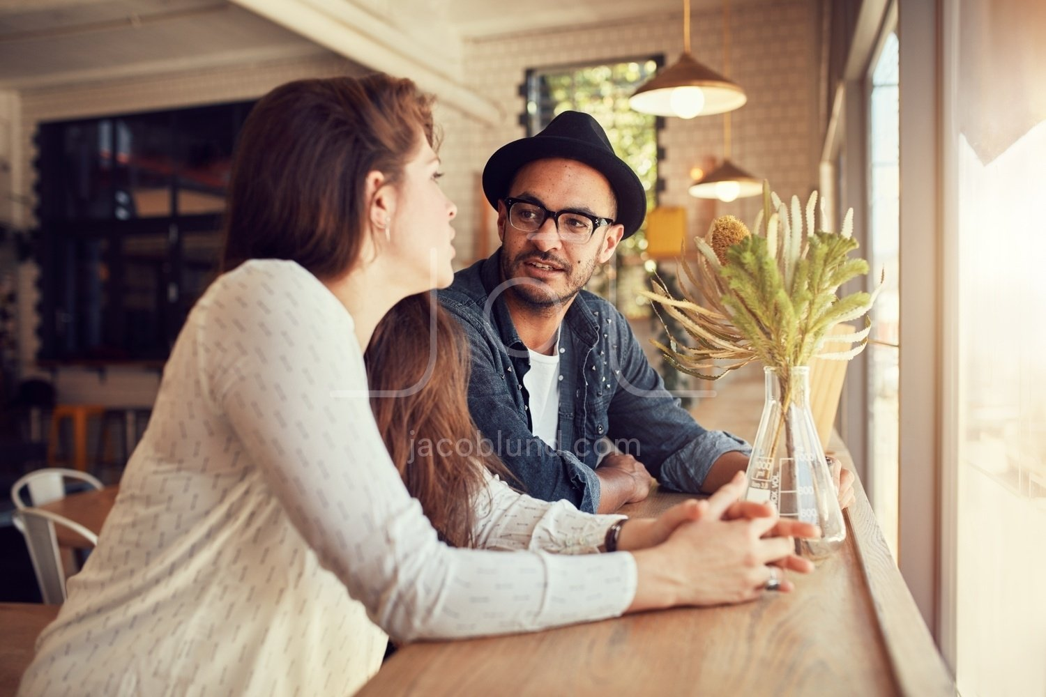 Young couple relaxing in a coffee shop. – Jacob Lund Photography ...