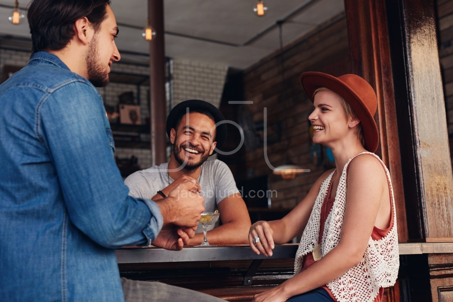 Young People Hanging Out At A Cafe Jacob Lund Photography Store Premium Stock Photo