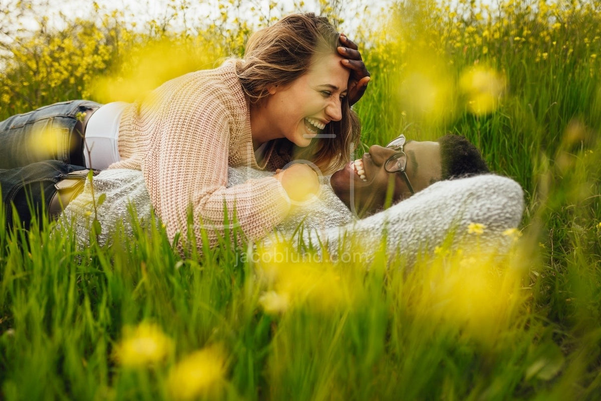 Interracial couple lying on grass and laughing – Jacob Lund ...