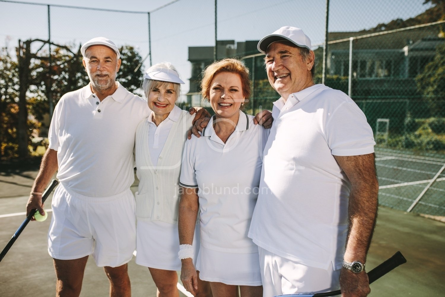 Senior Couples In Tennis Wear Standing In A Tennis Court Jacob Lund Photography Store Premium Stock Photo