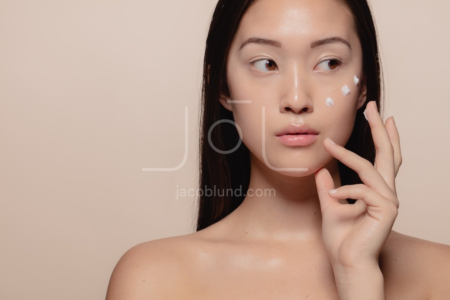 Trying Out A New Skincare Product Jacob Lund Photography Store Premium Stock Photo