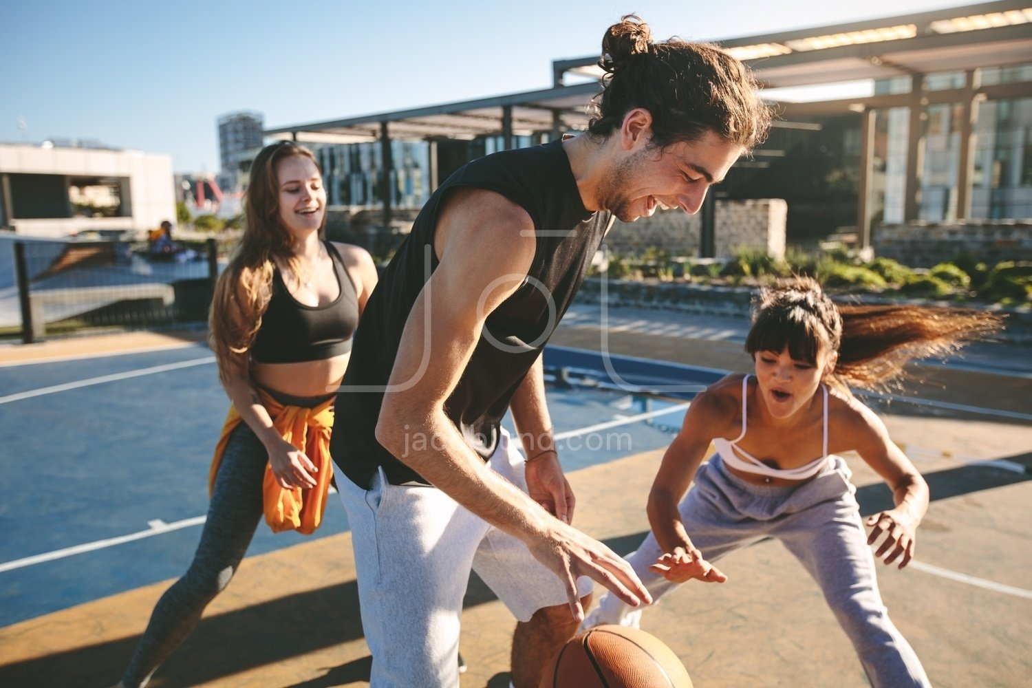 Friends Playing Basketball Game On Street Court Jacob Lund Photography Store Premium Stock Photo