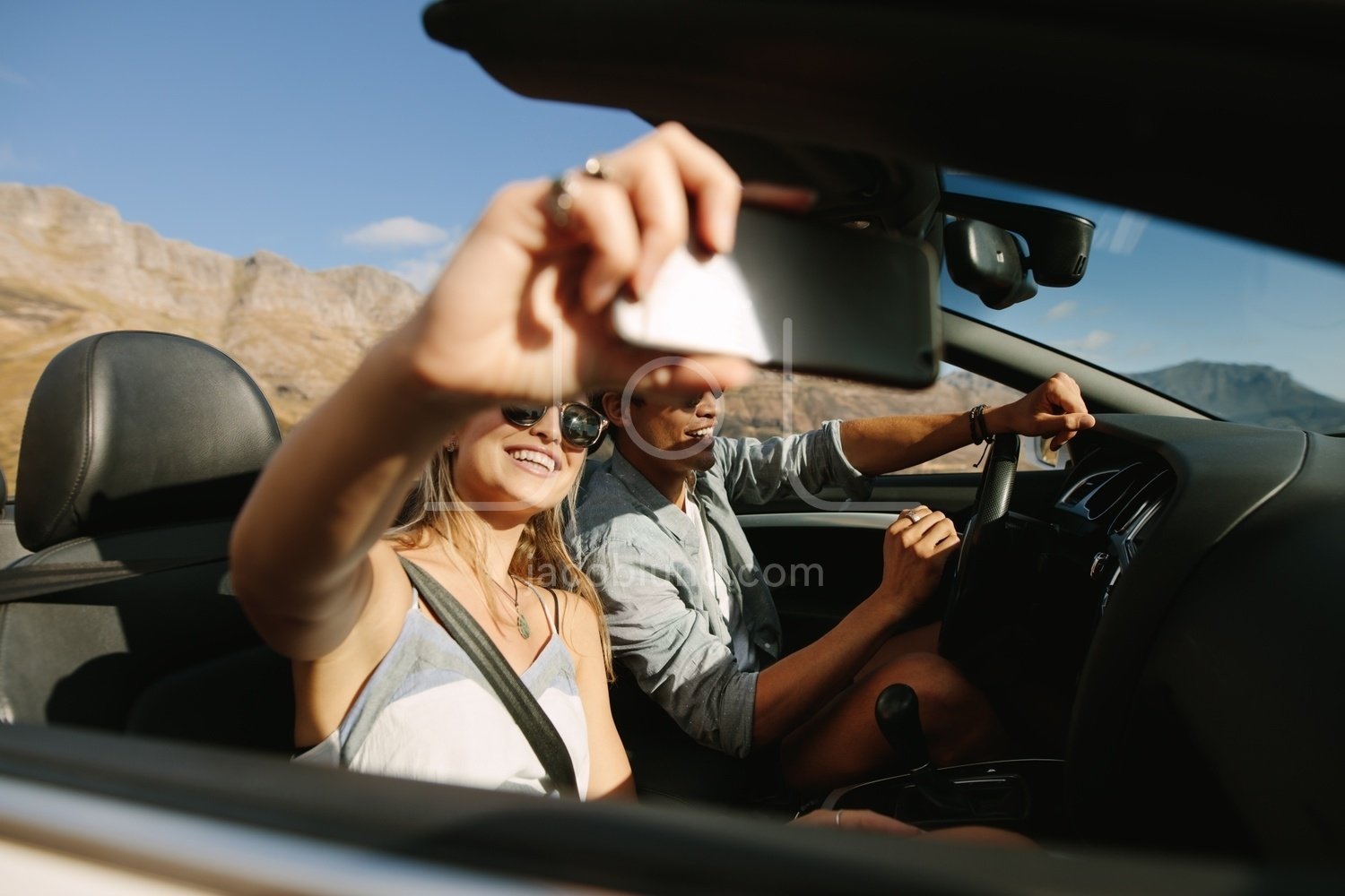 Couple On Road Trip In Convertible Car Taking Selfie Jacob Lund Photography Store Premium Stock Photo