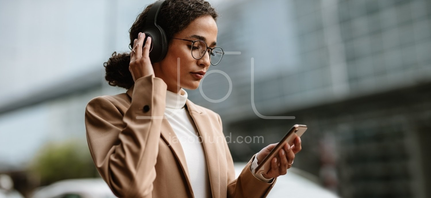 Businesswoman Using Truly Wireless Headphones While Commuting Jacob Lund Photography Store Premium Stock Photo