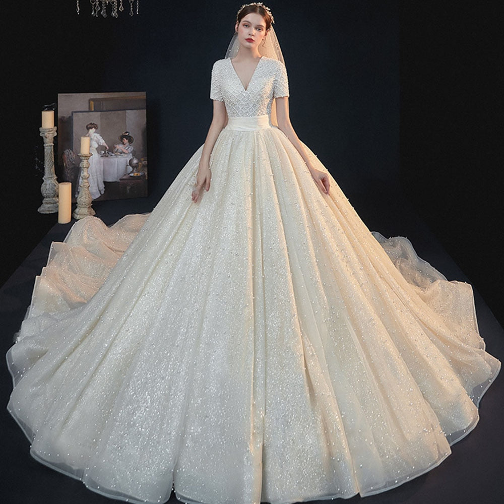 All Over Full Pearls Shiny Ball Gown Wedding Dress With Chapel Train Abiti Da Sposa V-neck Lace Up Short Sleeve Gorgeous Gowns