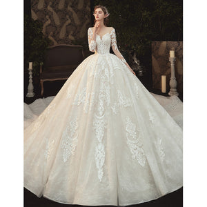 Beading Pearls Appliques Lace Illusion Princess Ball Gown Wedding Dress With Long Sleeve - LiveTrendsX